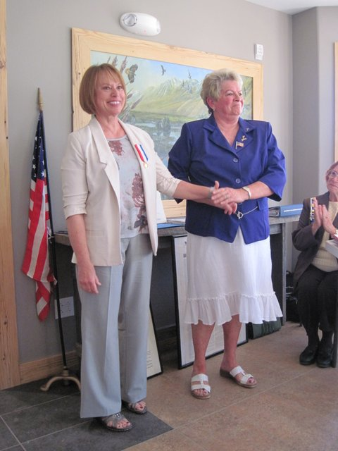 "Western Nevada College Professor Merilee Swirczek accepts the DAR Medal of Honor from the Daughters of the American Revolution for her exhibit ""Always Lost - A Meditation on War"""